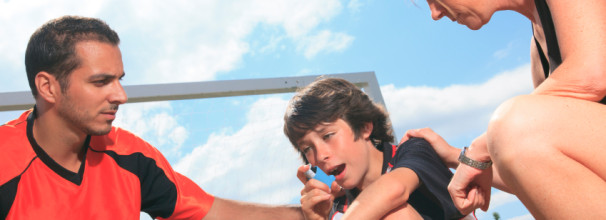 Young Soccer Player with Asthma Using Inhaler