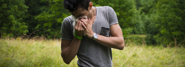 Young Man Sniffling from Seasonal Allergies
