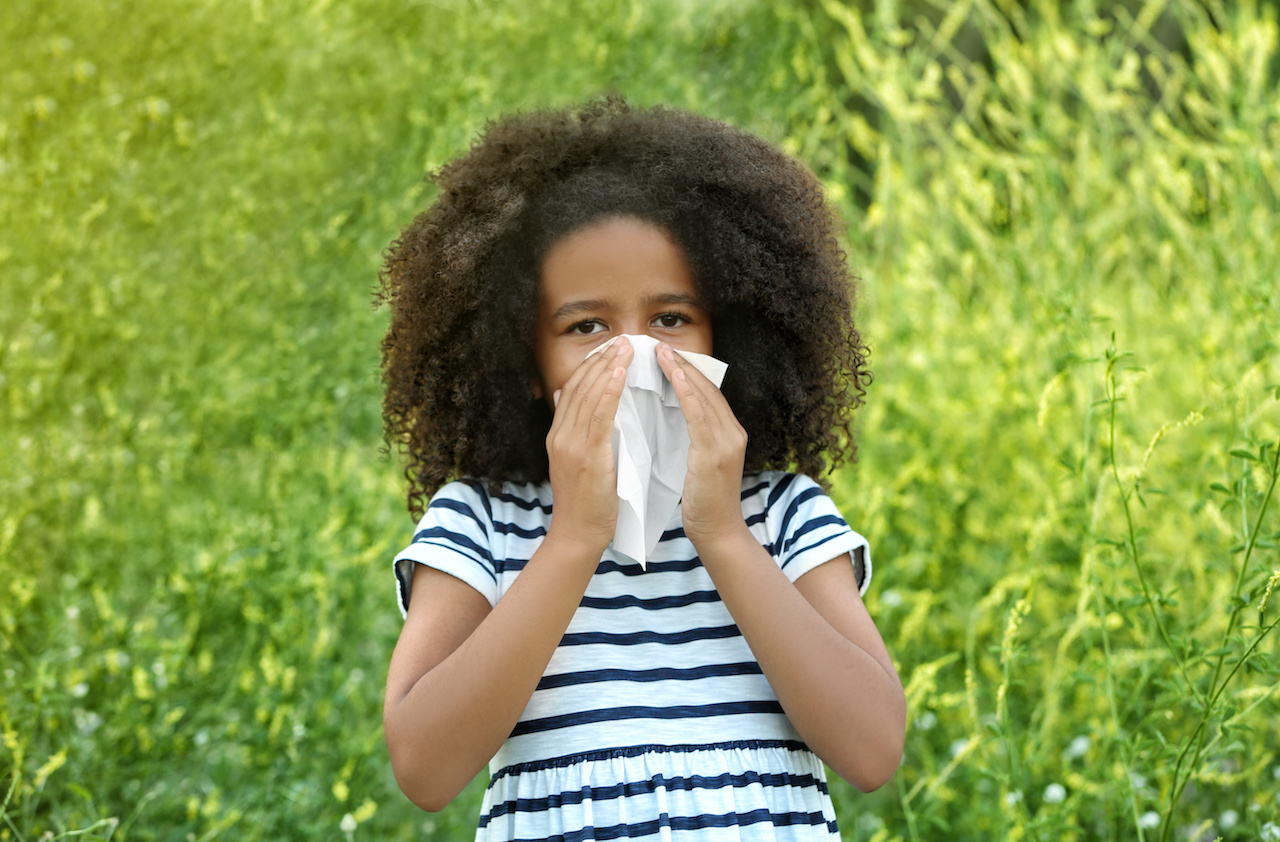 Young Girl Blowing Nose from Seasonal Allergies